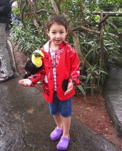 Toddler with a Toucan Parrot in Costa Rica